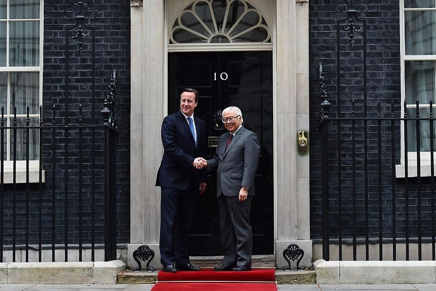 Britain's Prime Minister David Cameron with Singapore's President Tony Tan Keng Yam at No. 10 Downing Street in central London on Oct 22, 2014. -- PHOTO: AFP