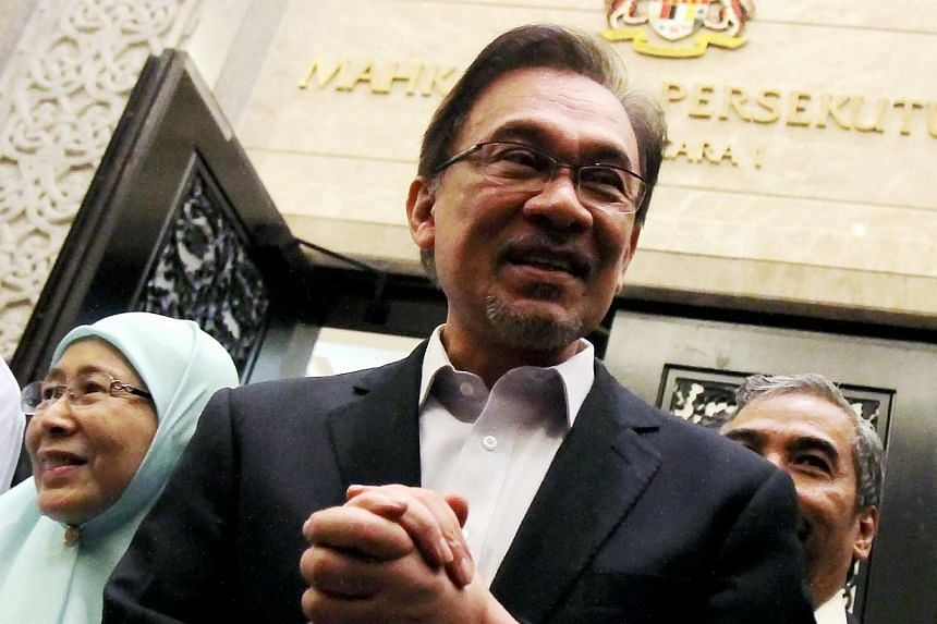 Datuk Sri Anwar Ibrahim accompanied by his wife Datin Sri Wan Azizah Wan Ismail leaving the court room at Palace of Justice to hear his appeal against conviction in Putrajaya. -- PHOTO: THE STAR/ASIA NEWS NETWORK