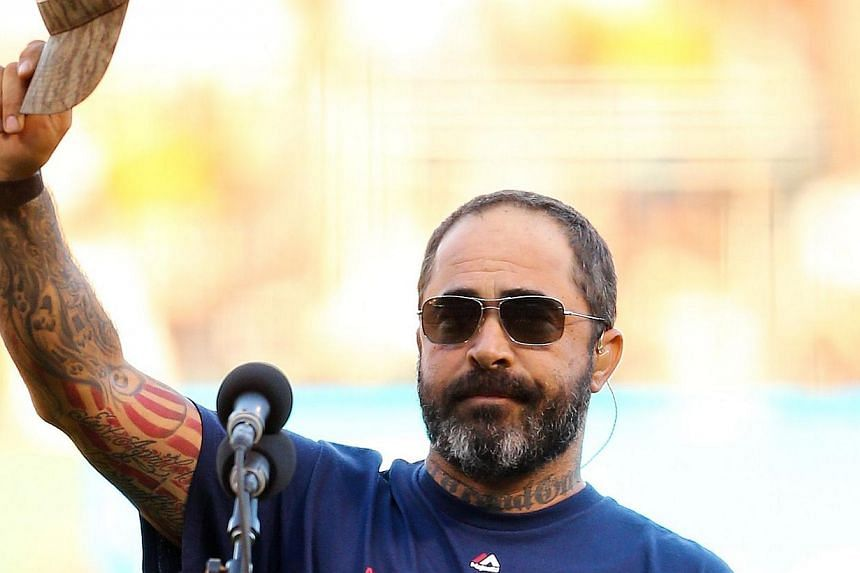 Singer Aaron Lewis performs the national anthem prior to Game Five of the 2014 World Series between the San Francisco Giants and the Kansas City Royals at AT&T Park in San Francisco, Californiaon Oct 26, 2014. -- PHOTO: AFP