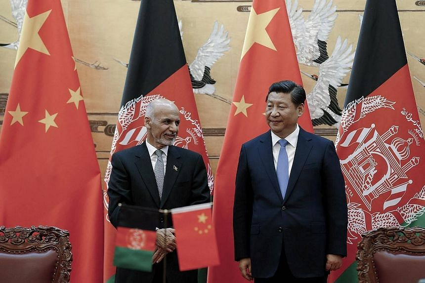 Chinese President Xi Jinping (right) with Afghan President Ashraf Ghani Ahmadzai attend a signing ceremony at the Great Hall of the People in Beijing on Oct 28, 2014.Mr Ghani has pledged to help China fight Islamist extremists, a senior Chinese