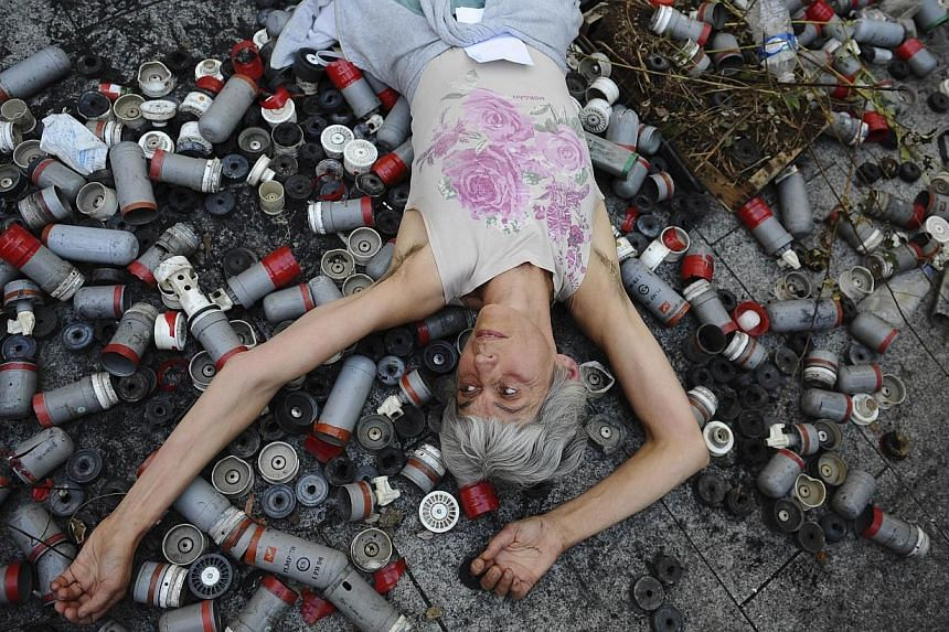 A protester lies on the ground during a demonstration in front of the prefecture in Albi, southern France on Oct 27, 2014, a day after a 21-year-old man died in unclear circumstances during a violent clash between demonstrators and police at the site
