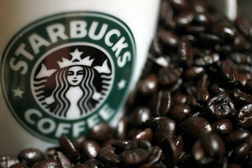 An overwhelming majority of readers who responded to an online poll by The Straits Times thought that Starbucks did the right thing in clearing the unattended belongings of a group of students. -- PHOTO: REUTERS
