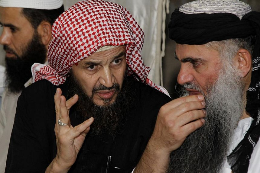 Jordanian security forces arrested influential Al-Qaeda spiritual guide Abu Mohammad al Maqdisi (right) on Monday on suspicion of fomenting terrorism on the Internet, security sources said. -- PHOTO: REUTERS