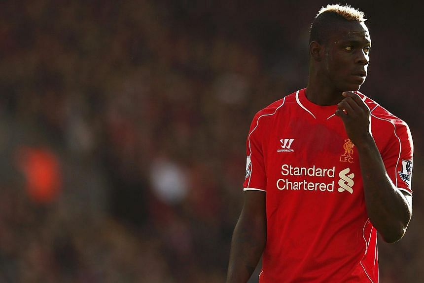 Liverpool striker Mario Balotelli will not face legal action over reports he threatened a woman for taking photographs of his Ferrari sports car, police announced on Tuesday. -- PHOTO: REUTERS