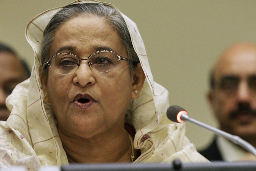 Bangladesh's Prime Minister Sheikh Hasina addresses a high-level summit on strengthening international peace operations during the 69th session of the United Nations General Assembly at United Nations headquarters in New York Sept 26. India's top cou