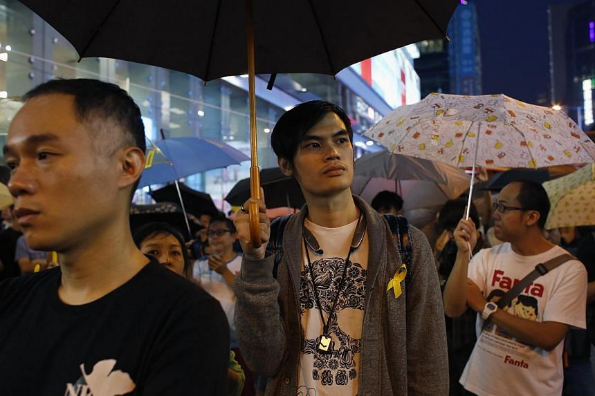 Pro-democracy protesters hold up umbrellas and as they take part in the one-month anniversary of the Occupy civil disobedience movement while blocking a main road at Mongkok shopping district in Hong Kong Oct 28, 2014. Nearly nine out of 10 Hong Kong
