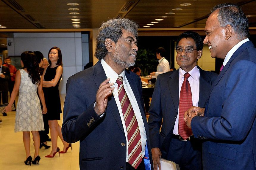 From Left: criminal lawyer Subhas Anandan talking to Noor Mohamed Marican , President of Association of Muslim Lawyers and Mr K Shanmugam, Minister for Law and Foreign Affairs at the reception.Ex-convicts released from prison will soon get fina
