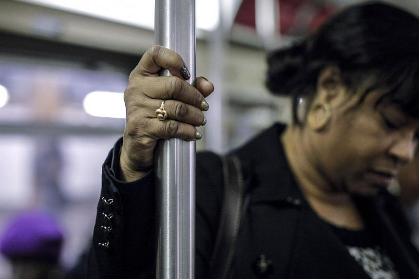 A woman rides the New York subway. The city has been rated as having the safest transport system for women, compared with 15 of the world's largest capitals. -- PHOTO: AFP