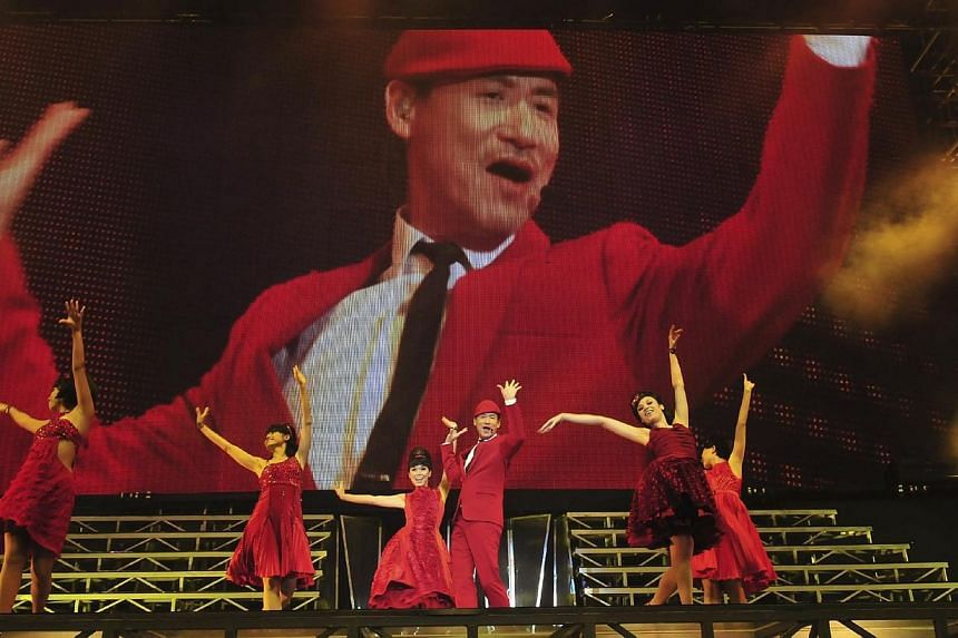 Hong Kong pop singer Jacky Cheung performing at his 1/2 Century Tour in Singapore.-- PHOTO:UNUSUAL ENTERTAINMENT