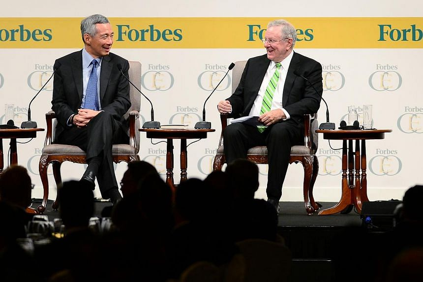 PM Lee and Mr Steve Forbes, chairman and editor-in-chief of Forbes Media, at the three-day Forbes Global CEO Conference, which brings business leaders together to discuss global economic issues.
