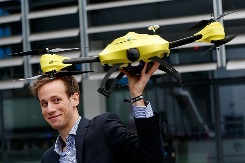 Belgian engineering graduate Alec Momont shows his design of an ambulance drone with a built-in defibrillator in Delft on Oct 28, 2014. The small aircraft, designed by Momont, weighs some 4kg and can fly at a speed of 100kmh, quickly delivering