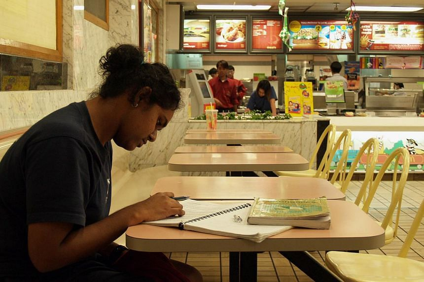 ST reporter Jalelah Abu Baker, then a student, studying at a McDonald's in 2005. -- PHOTO: ST FILE