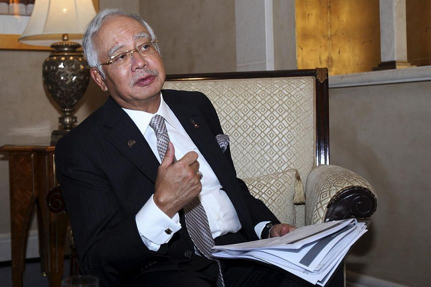 Malaysia's Prime Minister Najib Razak speaks to Reuters during the 10th World Islamic Economic Forum in Dubai Oct 28, 2014. Mr Najib vowed to bring to justice the perpetrators of the downing of Malaysia Airlines MH17, but said he feared fighting