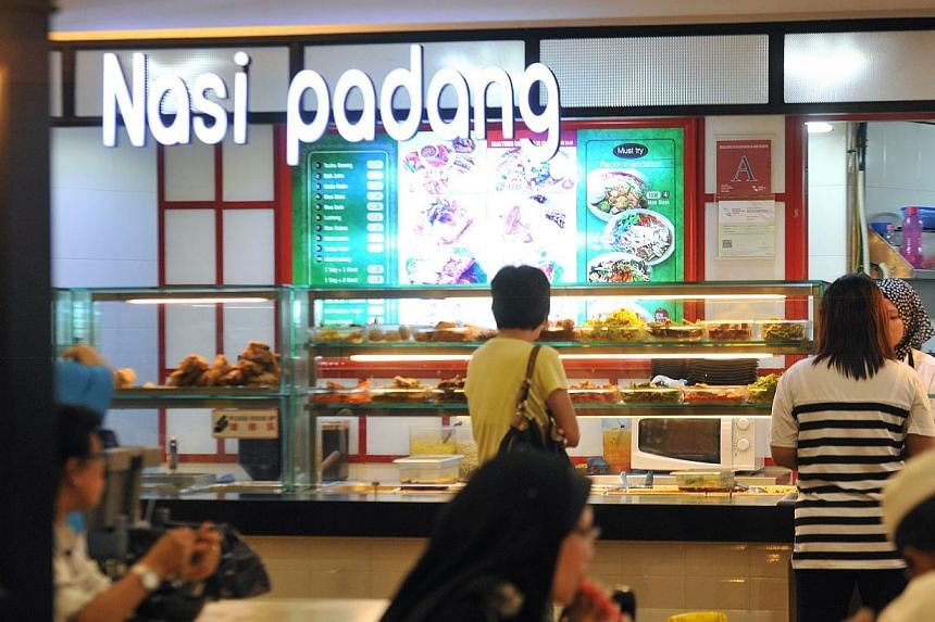 A four-year-old boy died four days after eating contaminated food bought from a nasi padang stall at a food court, a coroner's court heard. -- ST PHOTO: RUDY WONG