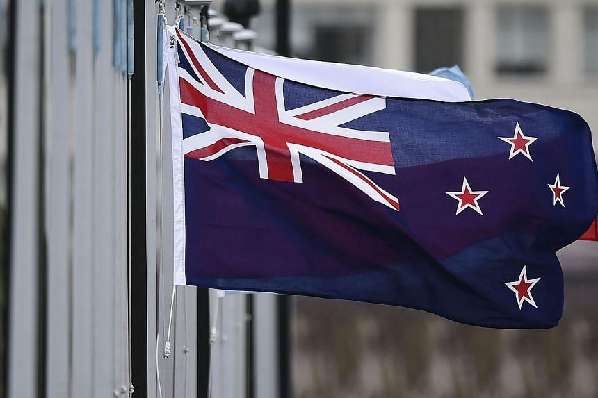 The New Zealand flag flutters outside Parliament buildings in Wellington in Wellington on Oct 29, 2014.New Zealand will be holding a vote on changing its national flag. -- PHOTO: AFP