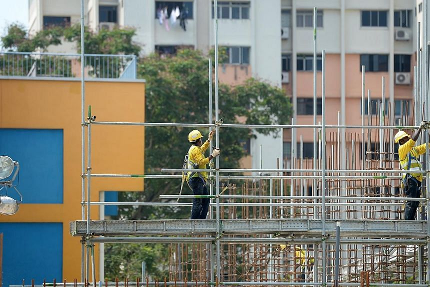 Firms in the construction sector will soon be required to have at least 10 per cent of their work permit holders to be classified as higher skilled, under a new rule which will take effect from Jan 1, 2017. -- PHOTO: ST FILE