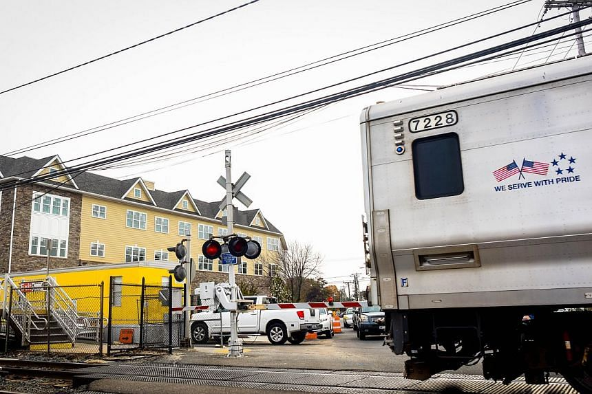A train passes near the alleged crime scene in Farmingdale, New York on Oct 29, 2014. -- PHOTO: AFP