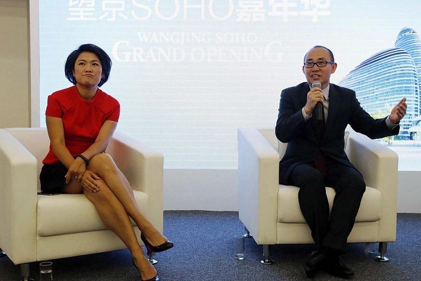 SOHO China chairman Pan Shiyi (right) with CEO Zhang Xin during a news conference to mark the opening of Wangjing SOHO, in Beijing on Sept 20, 2014. -- PHOTO: REUTERS
