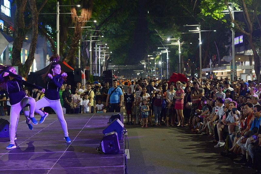 """The first edition of Pedestrian Night earlier this month saw tennis players """"taking over"""" a stretch of Orchard Road. This Saturday, it will be the turn of yoga enthusiasts."""