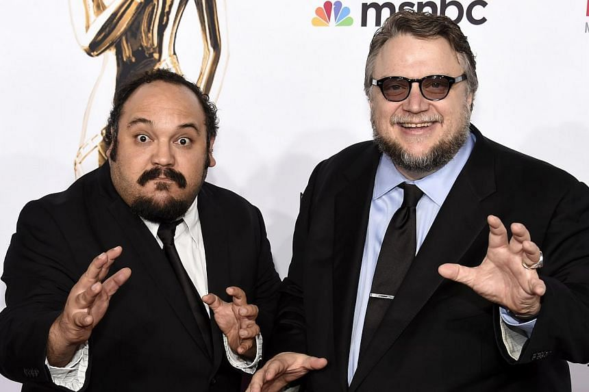 """""""The secret is that when you're talking about death, you're talking about life. And that is the message in the movie."""" - Producer Guillermo del Toro (right), on The Book Of Life, which is written and directed by Jorge Gutierrez (left) -- PHOT"""