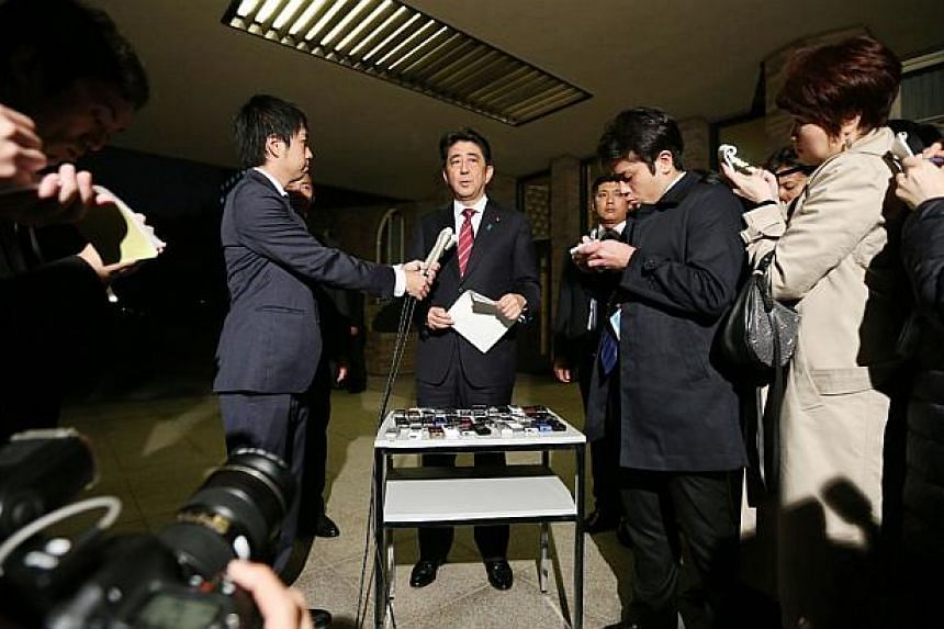 Japanese Prime Minister Shinzo Abe speaks to reporters at his official residence in Tokyo on Oct 30, 2014 after he met with a Japanese envoy who visited North Korea. Junichi Ihara, who heads the Japanese foreign ministry's Asian and Oceania Affairs B