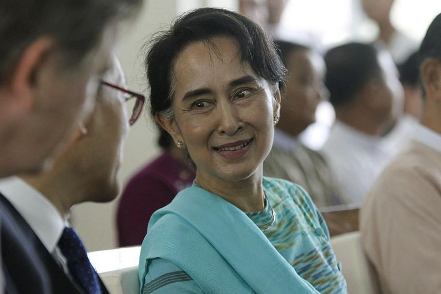 Myanmar opposition leader Aung San Suu Kyi, seen here (above) at an event outside Yangon on Oct 25, 2014, is expected to be among theheads of major political parties and ethnic groups who will meet with the government on Friday to discuss natio