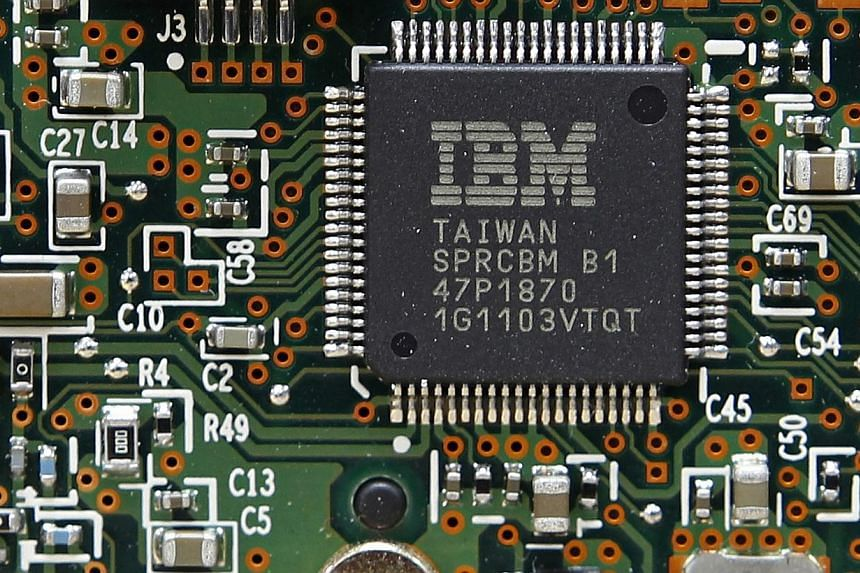 An IBM central processor unit is seen on a hard disk drive controller in Kiev, in this file photo from March 5, 2012. International Business Machines announced on Wednesday a partnership with Twitter to use data collected from tweets published around