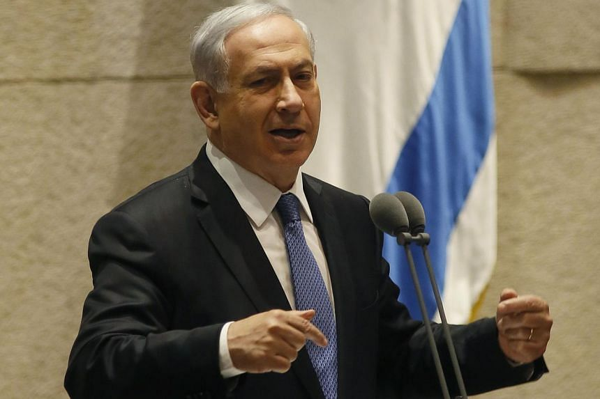 Israeli Prime Minister Benjamin Netanyahu gestures as he delivers a speech at the Knesset, Israel's parliament, on Oct 29, 2014 in Jerusalem. An article published online by The Atlantic magazine quoted officials of US President Barack Obama's adminis