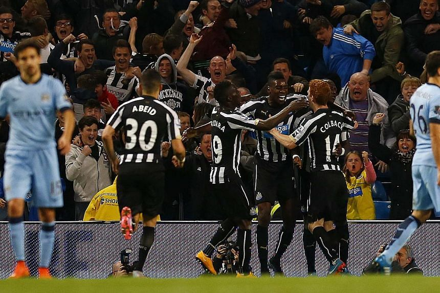 Newcastle players celebrate their team's second goal against Manchester City on Oct 29, 2014. -- PHOTO: REUTERS