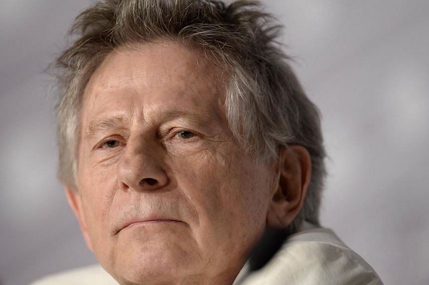 A photo taken on 2013 shows French Polish director Roman Polanski during a press conference for the film Venus in Fur presented in Competition at the 66th edition of the Cannes Film Festival in Cannes. -- PHOTO: AFP