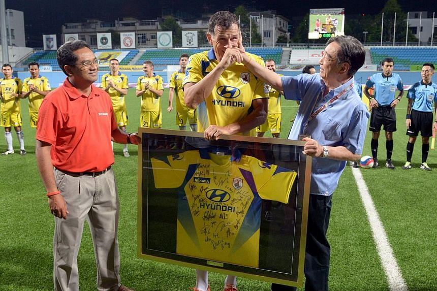 Aleksandar Duric reacts after being presented a framed-up jersey by FAS president Zainudin Nordin(left) and Tampines Rovers chairman Teo Hock Seng. This was Duric's last match, who retired after 15 years in the S-League, scoring a record 381 go