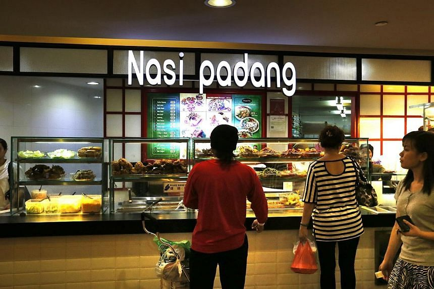 The National Environment Agency (NEA) will take legal action against a Nasi Padang stall located in Northpoint Shopping Centre. -- ST PHOTO:CHEW SENG KIM