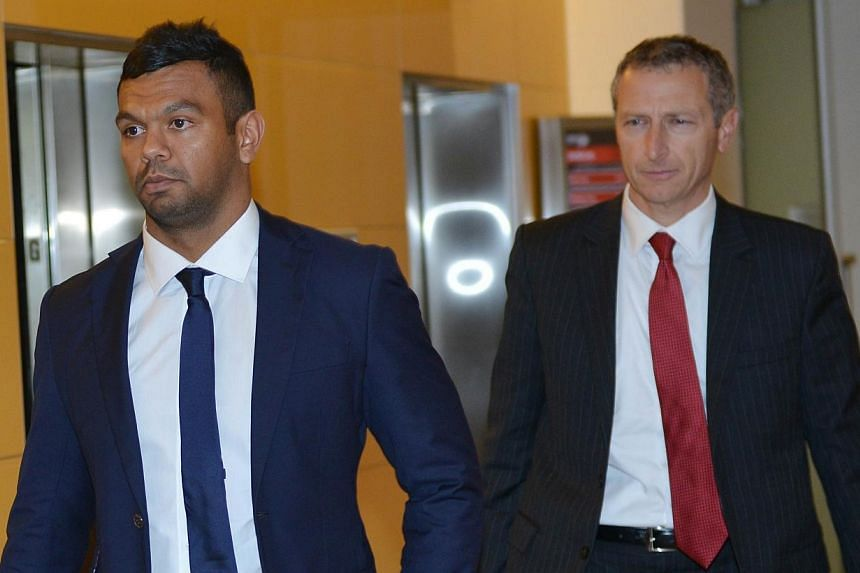 Wallabies rugby union player Kurtley Beale (left) arrives at the Australian Rugby Union (ARU) headquarters in Sydney for a ARU code of conduct hearing on Oct 24, 2014.Troubled Australia back Kurtley Beale has been issued with a last-chance warn