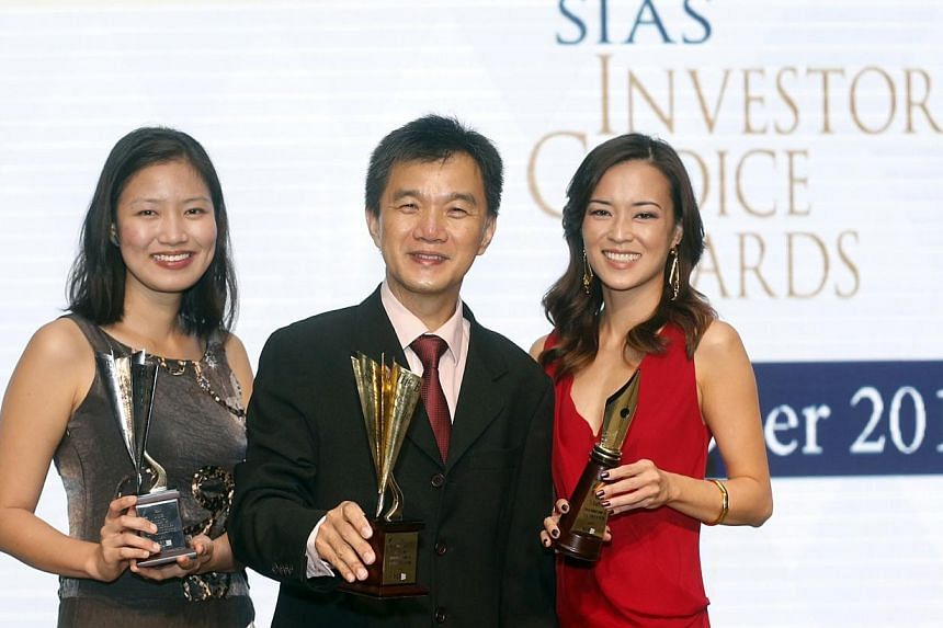 (From left) The Business Times journalist Lee Meixian, The Straits Times senior correspondent Goh Eng Yeow, and The Business Times senior correspondent Michelle Quah with their awards as the Securities Investors Association (Singapore) (SIAS) celebra
