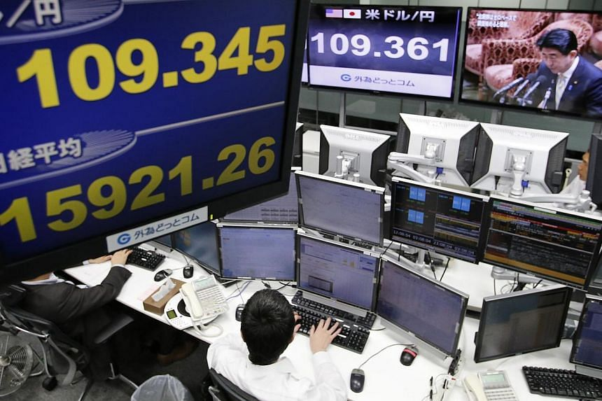 Tokyo shares soared 4.83 per cent to a seven-year high on Friday after the Bank of Japan ramped up its vast monetary easing programme, sending the yen into freefall. -- PHOTO: REUTERS
