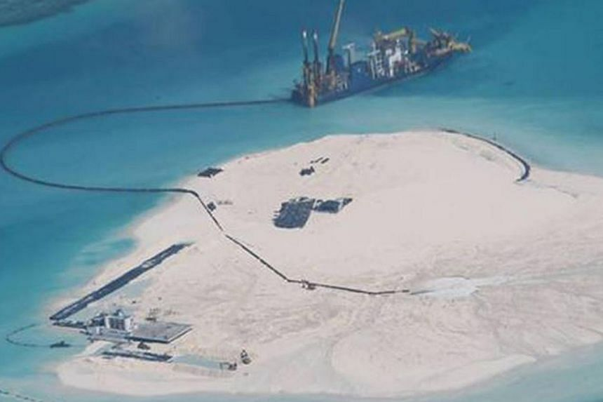 A photograph taken in February of the Johnson South Reef in the South China Sea, a reef occupied by China but also claimed by the Philippines and Vietnam. According to the Philippine Foreign Affairs Department, this photo appears to show large-scale