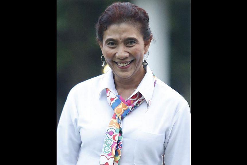 Susi Pudjiastuti, 49, Maritime and Fisheries Minister. -- PHOTOS: JAKARTA POST/ASIA NEWS NETWORK, AGENCE FRANCE-PRESSE