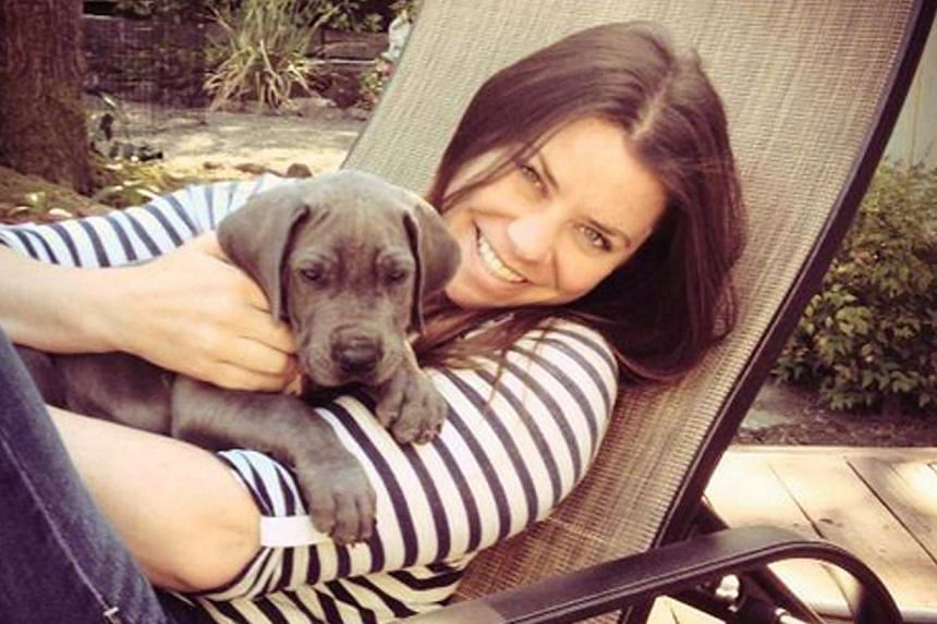 A 2013 photo obtained on Oct 30, 2014 shows Brittany Maynard and her Great Dane puppy Charlie. TheAmerican 29-year-old with terminal brain cancer whose video about planning to kill herself on Nov 1 went viral, says she will hold on a little lon