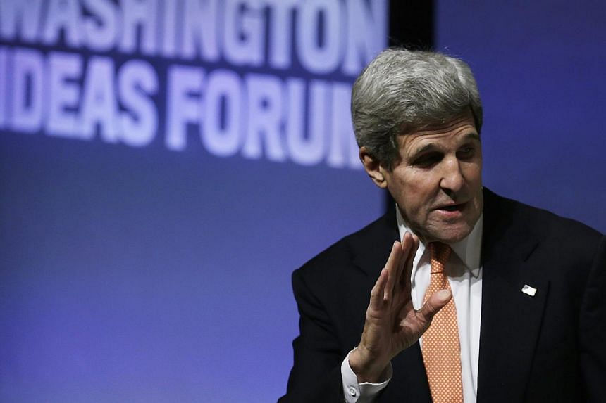 "US Secretary of State John Kerry gestures at the Washington Ideas Forum in Washington on Oct 30, 2014. The description of Israeli Prime Minister Benjamin Netanyahu as a ""chickenshit"" by an anonymous US official as quoted in a US magazine this week wa"