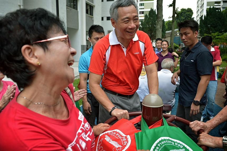 Prime Minister Lee Hsien Loong at the launch of Ang Mo Kio Town Council's clean and green campaign in conjunction with Ang Mo Kio GRC and Sengkang West SMC's Annual Tree Planting Day. -- ST PHOTO: KUA CHEE SIONG