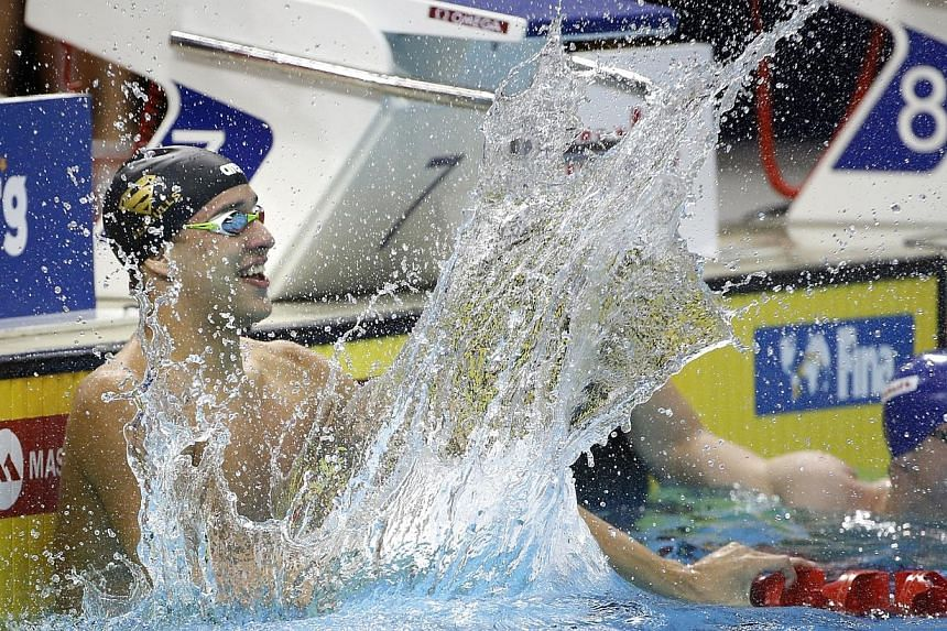 South Africa's Chad Le Clos reacts after winning the men's 50m butterfly event in the Fina/Mastbank Swimming World Cup at the OCBC Aquatic Centre on Saturday, Nov 1, 2014. -- ST PHOTO: KEVIN LIM