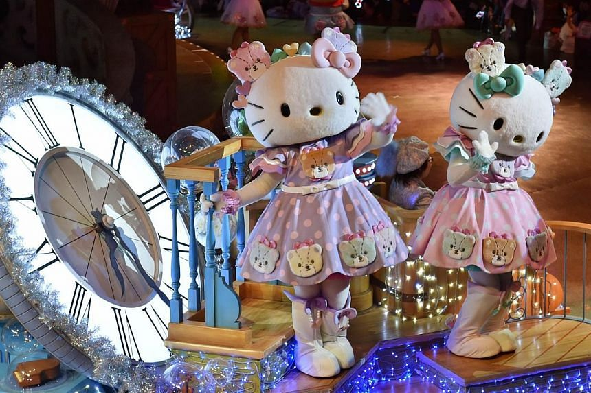 Hello Kitty (left) and her twin sister Mimmy (right) celebrate in the Hello Kitty 40th anniversary parade at Tokyo's Sanrio Puroland on Nov 1, 2014. -- PHOTO: AFP
