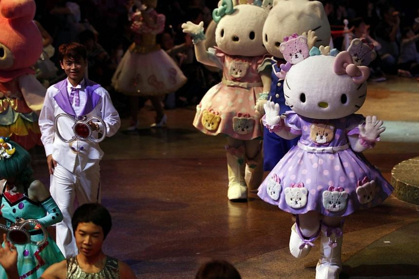 Hello Kitty waves during an event to celebrate her 40th birthday at Sanrio Puroland theme park in Tokyo on Nov 1, 2014. -- PHOTO: REUTERS