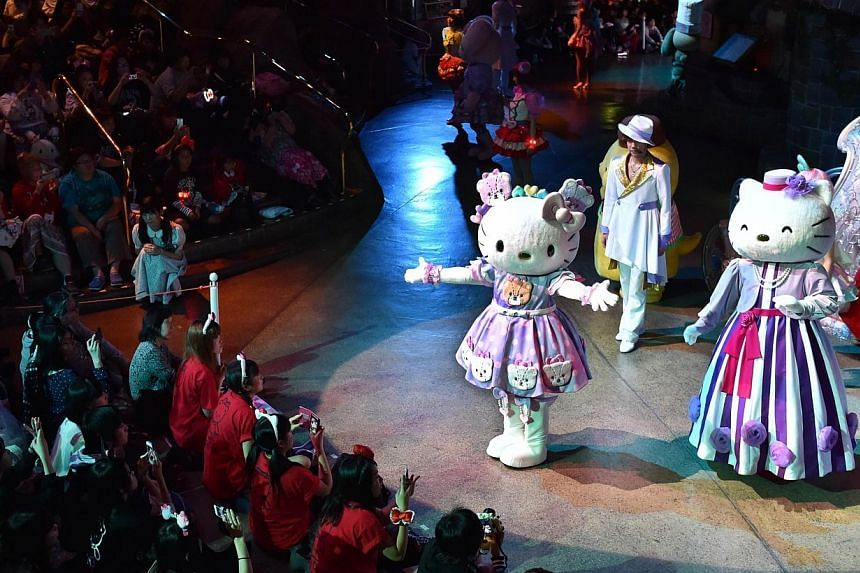 Hello Kitty (centre) performs with Sanrio characters in the Hello Kitty 40th anniversary parade at Tokyo's Sanrio Puroland on Nov 1, 2014. -- PHOTO: AFP