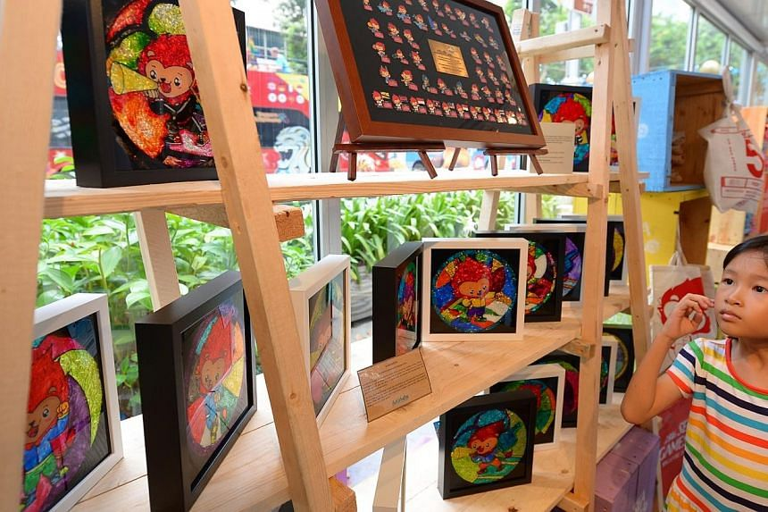 Shoppers in Orchard Road were treated to a new retail outlet on Saturday with the launch of the first official merchandise store for the 28th SEA Games. -- ST PHOTO:NG SOR LUAN