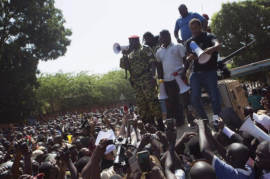 Lieutenant Colonel Yacouba Isaac Zida of Burkina Faso's presidential guard speaks to anti-government protesters in front of army headquarters in Ouagadougou, capital of Burkina Faso on Oct 31, 2014. -- PHOTO: REUTERS