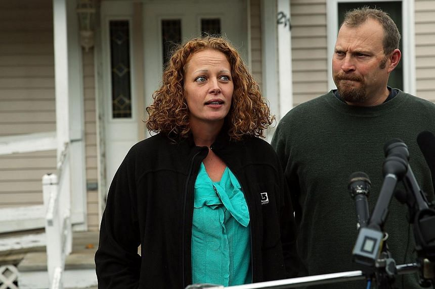 Kaci Hickox stands with her boyfriend Theodore Michael Wilbur as she gives a statement to the media in front of her home in Fort Kent, Maineon Oct 31, 2014. -- PHOTO: AFP
