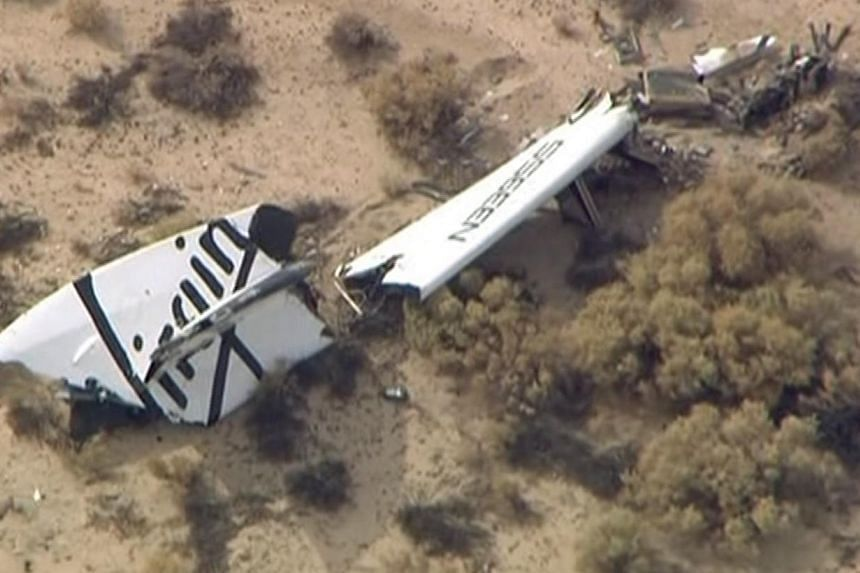 Wreckage from Virgin Galactic's SpaceShipTwo is shown in this still image captured from KNBC video footage from Mojave, California on Oct 31, 2014. -- PHOTO: REUTERS