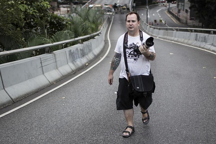 Camera-toting Dan Garrett has been targeted by pro-Beijing media and politicians in Hong Kong as evidence of a Western conspiracy behind the current unrest in the city.