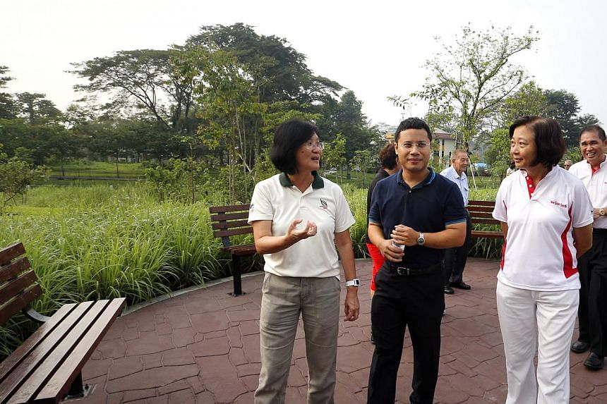 Mr Desmond Lee (second from left) and Dr Lee Bee Wah (right) tour the Springleaf Nature Park. -- ST PHOTO: CHEW SENG KIM